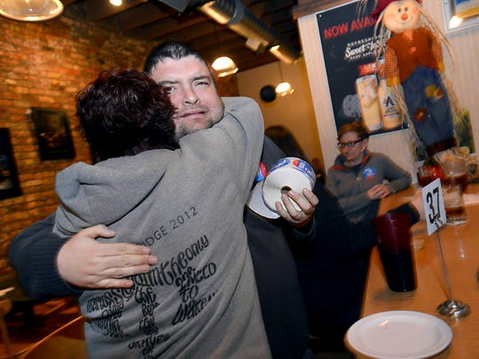 Same sex marriage supporters Dawn Smith and Frank Vaca hug as groups and individuals  supporting same sex marriage gather in   Lansing   Thursday evening 11/6/2014  to discuss the federal appeals court ruling upholding Michigan's gay marriage  ban .   (Lansing State Journal   Rod Sanford)