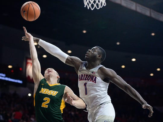 North Dakota State Bison guard Paul Miller (2) and Arizona Wildcats guard Rawle Alkins (1) battle for the ball during the first half at McKale Center.