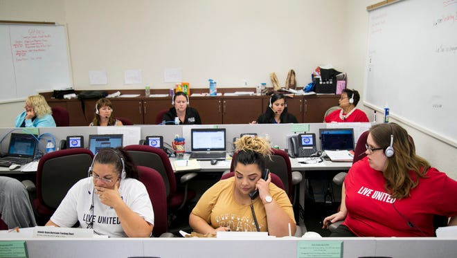 United Way employees and volunteers answer calls to the 211 hotline to help facilitate evacuations and shelter placement ahead of Hurricane Irma on Thursday, September 7, 2017, at the Lee County Emergency Operations Center in Fort Myers.