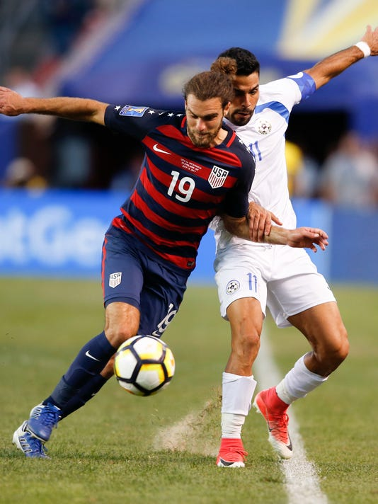 United States' Graham Zusi (19) controls the ball against Nicaragua's Juan Barrera (11) during a CONCACAF Gold Cup soccer match in Cleveland, Ohio, Saturday, July 15, 2017. (AP Photo/Ron Schwane)