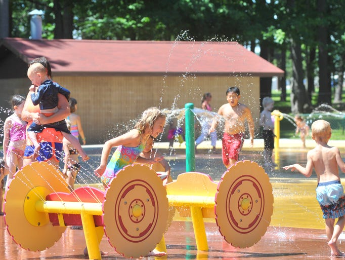 Parents and kids enjoy getting soaked Tuesday afternoon at the Marathon County Park Splash Pad in Wausau.