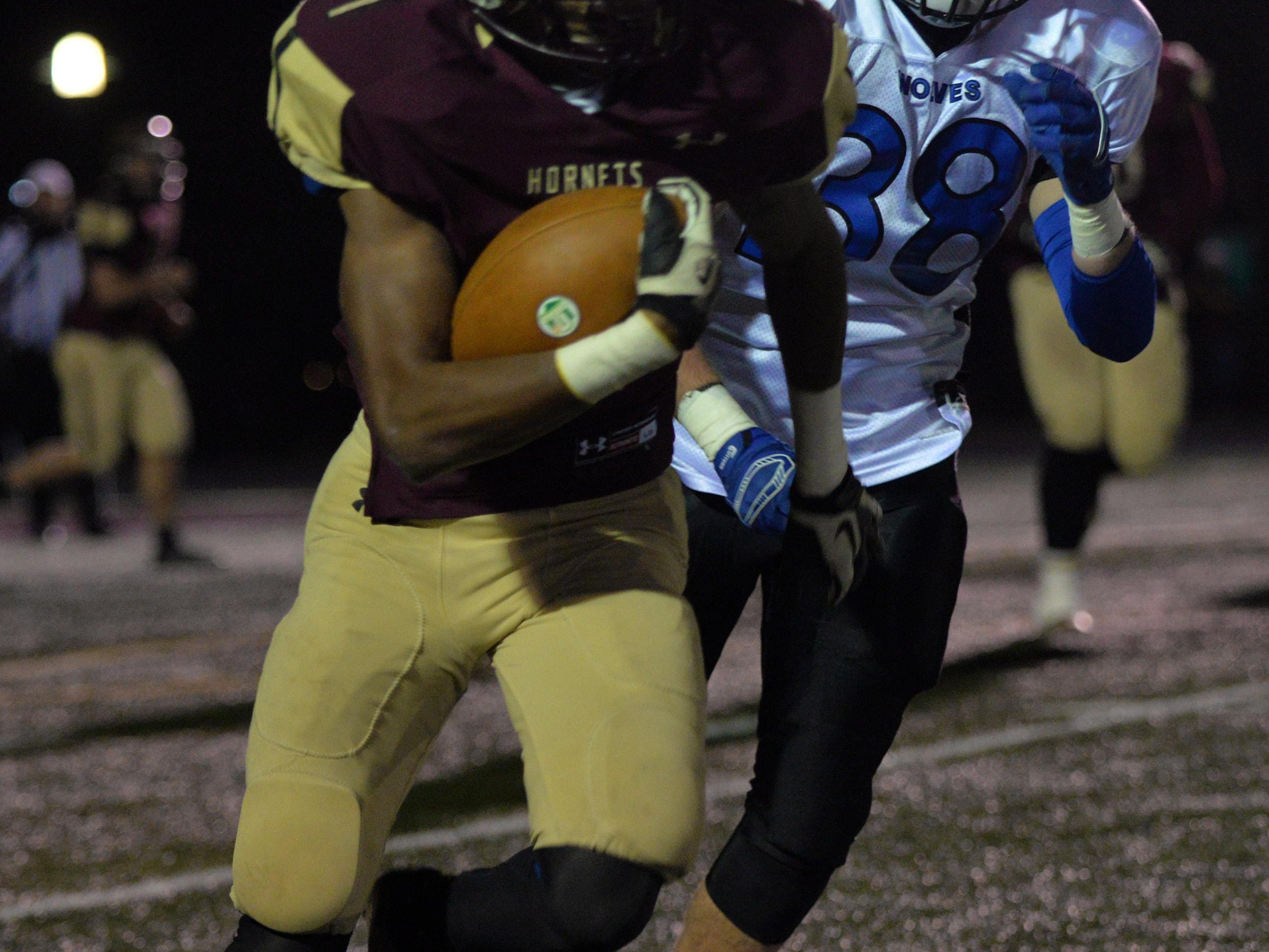 Licking Heights senior London Pearson runs away from a Worthington Kilbourne defender during a Division II playoff game Nov. 13. Pearson was named to the All-Ohio first team on Monday.