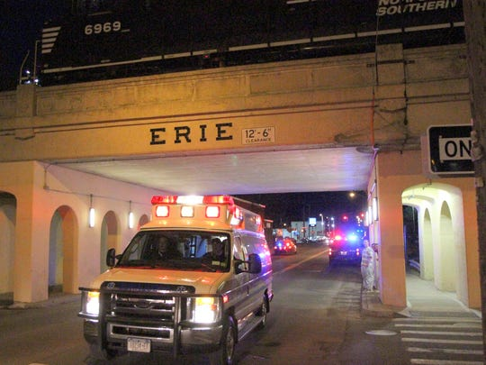 An Erway ambulance leaves the scene of where a Norfolk Southern train struck a person on the viaduct in Elmira Wednesday evening.