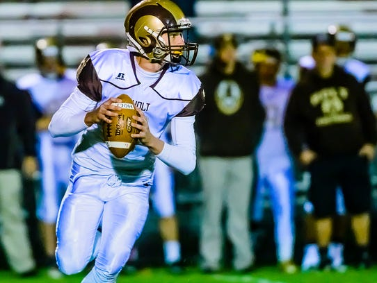 Kolin Leyrer was a star quarterback at Holt High School who earned honorable mention all-league honors. He was a senior in 2017 and just finished his first year with Eastern Michigan's wrestling team. He may transfer because officials decided Tuesday to cut the sport.
