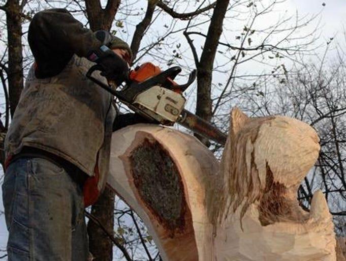 Farmington hills maple carved into squirrel sculpture