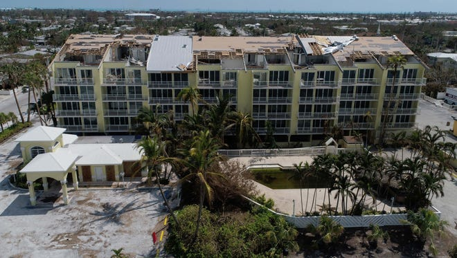 Sections of the roof are seen peeled off on the Bayside Hotel on Sept. 13, 2017, in Key West, Fla., after Hurricane Irma.