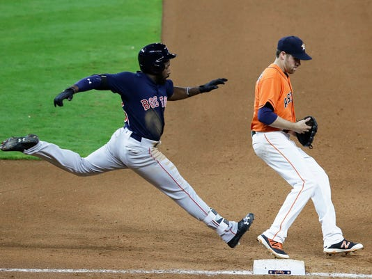 Houston Astros starting pitcher Collin McHugh, right, steps on first base for the out on Boston Red Sox's Jackie Bradley Jr. during the fourth inning of a baseball game Friday, April 22, 2016, in Houston. (AP Photo/Pat Sullivan)