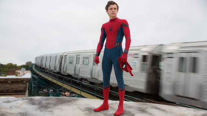 Peter Parker (Tom Holland) juggles school life and his new superhero gig in 'Spider-Man: Homecoming.'