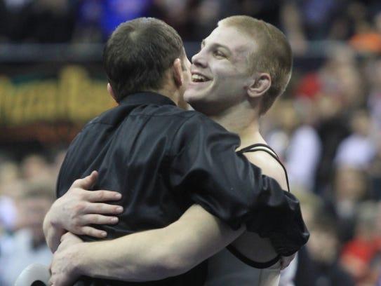 2013: Jake Marlin of Creston-OM celebrates after defeating