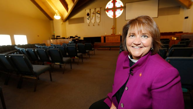 Bishop Karen Oliveto sits in the sanctuary of a United Methodist Church near her office in Highlands Ranch, Colo., on April 19, 2017.