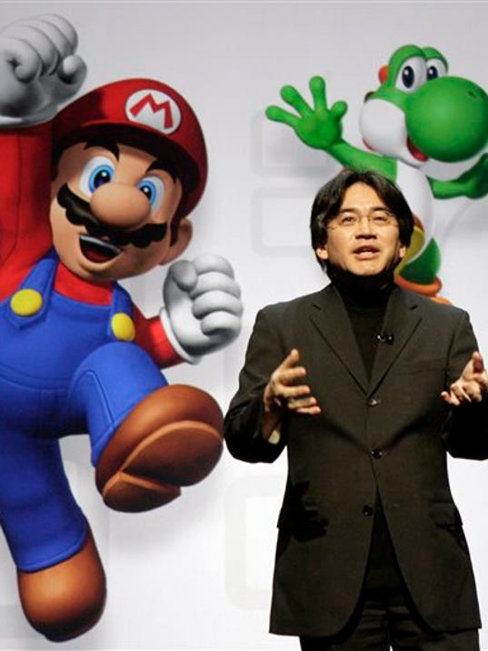 FILE - In this July 15, 2008 file photo, Satoru Iwata, President and CEO of Nintendo Co. Ltd., speaks at a news conference where Nintendo unveiled an enhancement for its Wii Remote controller and new games at the E3 Media and Business Summit in Los Angeles.