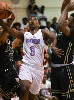 Zay Stevens of Rockledge drives to the basket in traffic during a recent game against Viera.
