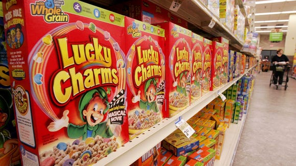 FILE - In this Sept. 21, 2006 file photo, a shelf of General Mills Lucky Charms cereal in a Giant Eagle grocery in Pittsburgh, is shown. General Mills _ the maker of Lucky Charms, Trix and Cocoa Puffs _ said Wednesday, Dec. 9, 2009, it will further reduce the amount of sugar in its cereals marketed to children.  (AP Photo/Gene J. Puskar, file)