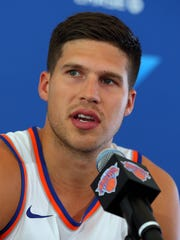 Knicks forward Doug McDermott speaks to the media on