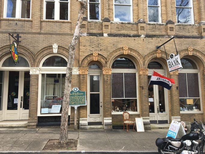 The Bank Antiques & More is located in the building