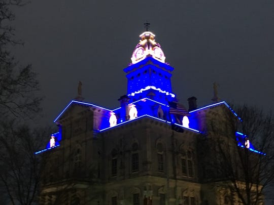 The Licking County Courthouse was lit blue to honor the Westerville police officers killed on Saturday.