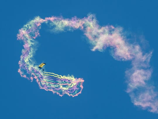 A member of the United States Navy Seals Leap Frogs parachutes onto the beach during the OC Air Show. The show includes acrobatics and formations by civilian and military aircraft, including the U.S. Air Force Thunderbirds. The OC Air Show continues Sunday, with show center at 16th Street oceanside.