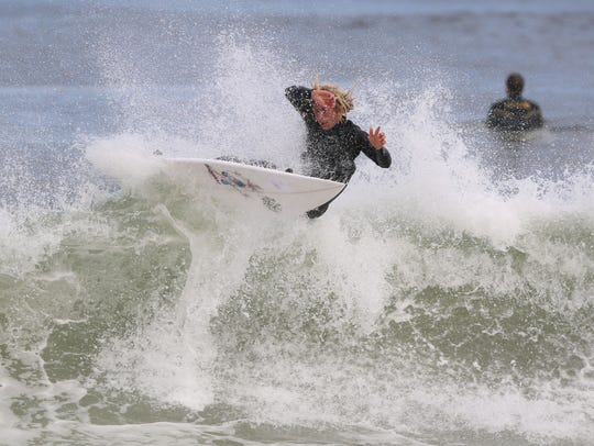 Surfers enjoy a good day of waves with offshore winds