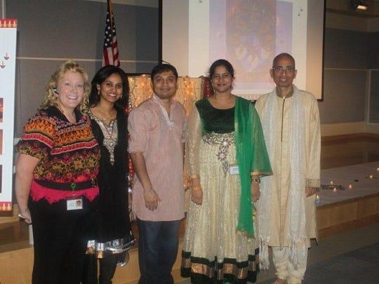 Enjoying the lights of Diwali at Corning Inc.'s Sullivan Park are from left: Susan Prescott, Shilpa Akunuri, Tapan Patel, Sravani Gogineni, and Rama Kandala.