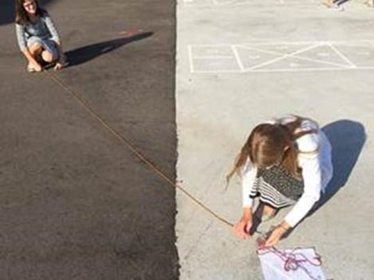 The sixth-grade students at St. Mary Catholic Middle School recently practiced using a compass to take measurements. Lilly Griffith and Anna Vanden Acker worked as a team.