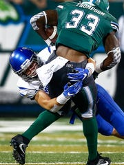 University of Memphis defensive back Austin Hall (left) brings down Tulane University running back Lazedrick Thompson (right) behind the line of scrimmage during third quarter action at Yulman Stadium in New Orleans.