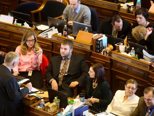 Rep. Jake Highfill, 24, talks with others at the Statehouse on Thursday morning.