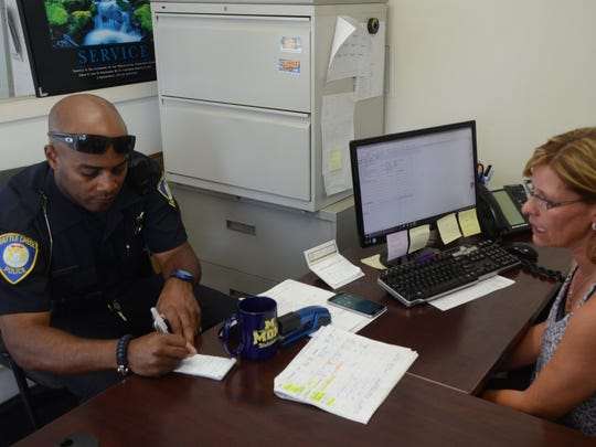 Officer Mark Tillman took information from Kandi Garrett, service manager at Lakeview Ford, on Friday.