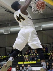 Dee Smith puts down a dunk during the second quarter on Friday night at the Tiger Pit.