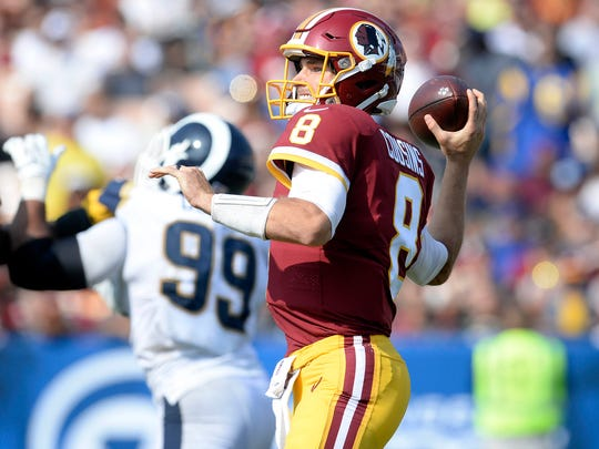 Washington Redskins quarterback Kirk Cousins  throws against the Los Angeles Rams during the second half at Los Angeles Memorial Coliseum.