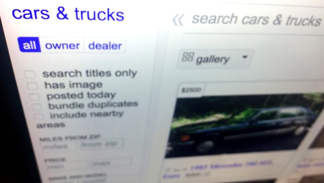This photo shows listings for cars and trucks for sale on a website Tuesday, June 19, 2018, in New York. Fraud is widespread in the private-party online car-buying market, and unless buyers are careful, they can lose thousands of dollars.