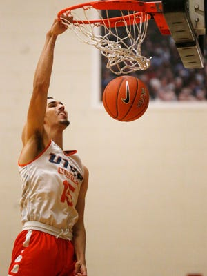 UTEP guard Kobe Magee slams in the basketball during practice Friday afternoon as the Miners prepare for their exhibition game Saturday in the Don Haskins Center. The game will pit the returning players against the new recruits who will make their debut.