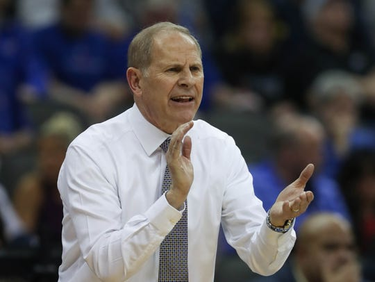 Michigan coach John Beilein on the bench during the