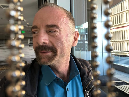 "Timothy Ray Brown poses for a photograph March 4, 2019, in Seattle. Brown, also known as the ""Berlin patient,"" was the first person to be cured of HIV infection, more than a decade ago. Now researchers are reporting a second patient has lived 18 months after stopping HIV treatment without sign of the virus following a stem-cell transplant."