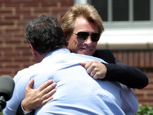Gov. Chris Christie gets a hug from Jon Bon Jovi in Sayreville.