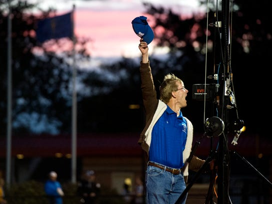Memorial Tigers football manager Aaron Coomer cheers