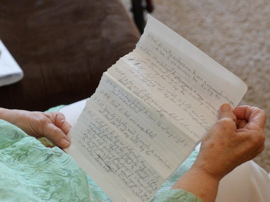 Barbara King looks over a letter from her son, Roger King about his lack of healthcare in the South Dakota penitentiary, June 1, 2015.