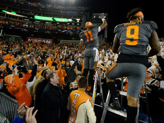 Tennessee Volunteers quarterback Joshua Dobbs (11) and defensive end Derek Barnett (9) help lead the band after the team's 38-24 win over Nebraska in the Franklin American Mortgage Music City Bowl at Nissan Stadium in Nashville, Tenn., Friday, Dec. 30, 2016.