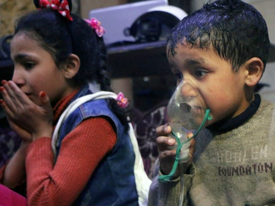 This image released early April 8, 2018, by the Syrian Civil Defense White Helmets shows a child receiving oxygen through respirators following an alleged poison gas attack in the rebel-held town of Douma, near Damascus, Syria.