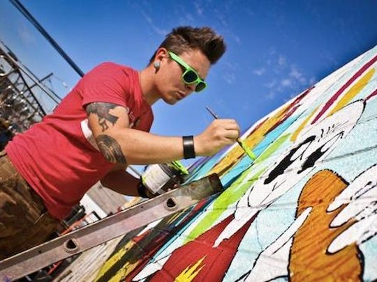 Artist Jesse Perry of Phoenix is known for his mural