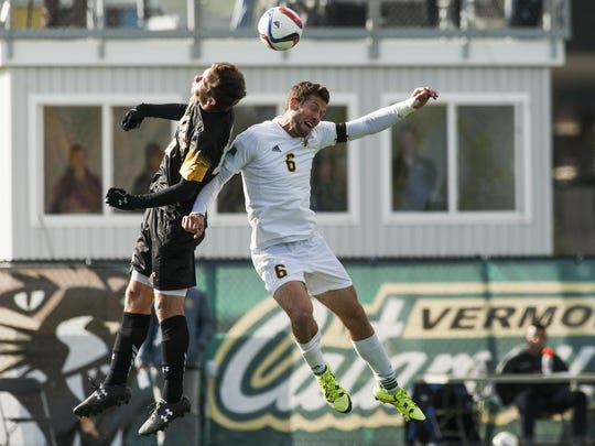 Vermont's Skyler Davis (6) battles for the header with UMBC's Gregg Hauck (13) during the men's soccer game between the UMBC Retrievers and the Vermont Catamounts at Virtue Field on October 14, 2015 in Burlington.