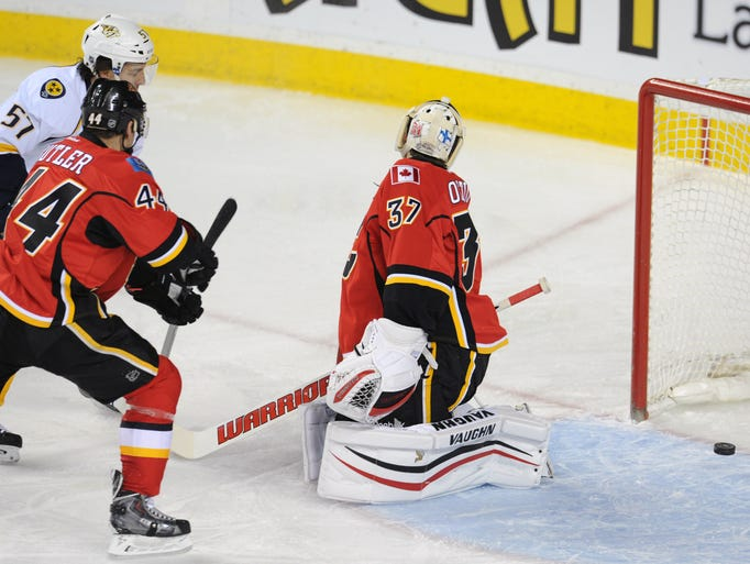 Calgary goalie Joni Ortio (37) is scored on by Predators defenseman Victor Bartley (not pictured) during the first period.