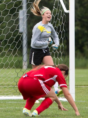 Ankeny High School's Adrienne Beardsley celebrates a missed shot by North Scott's Shelley Matthys during penalty kicks Friday, June 12, 2015, during the IHSAA State Soccer Championships at the Cownie Soccer Complex in Des Moines.