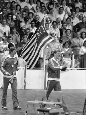 U.S. swimmers Jim Montgomery, right, and Jack Babashoff paraded with their medals on July 25, 1976. Montgomery won gold and Babashoff silver in the men's 100-meter freestyle.