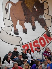 Community support in the stands at the Bison gym in Grayville Tuesday, January 23, 2018.
