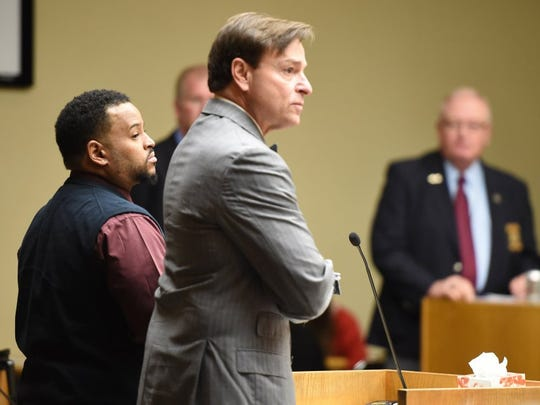 Norman Clark, left, with his attorney Gregory P. Isaacs, listens during a hearing in which the state announced he will be retried for killing his girlfriend, Brittany Eldridge, and their unborn son Wednesday, Jan. 6, 2016, in Knox County Criminal Court. (AMY SMOTHERMAN BURGESS/NEWS SENTINEL)