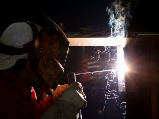 GABE HERNANDEZ/CALLER-TIMES Alex Longoria from Victoria East High School competes during the Nueces County Junior Livestock Show's welding competition Friday, Jan. 8, 2016, at the Richard M. Borchard Regional Fairgrounds in Robstown.