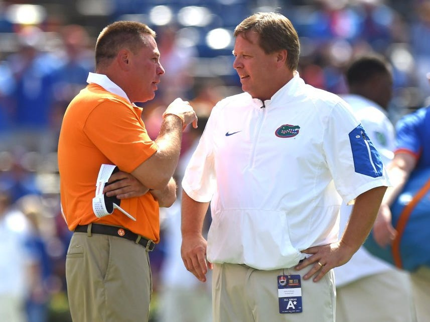 Tennessee head coach Butch Jones and Florida head coach Jim McElwain, from left, meet on the field before the Tennessee-Florida game at Ben Hill Griffin Stadium in Gainesville, Fla. on Saturday, Sept. 26, 2015. (ADAM LAU/NEWS SENTINEL)