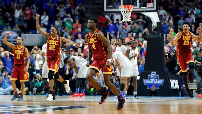 Southern California's Jordan McLaughlin (11), De'Anthony Melton (22), Chimezie Metu (4) and Bennie Boatwright (25) celebrate their 66-65 win over SMU in a first-round game in the men's NCAA college basketball tournament in Tulsa, Okla., Friday March 17, 2017.