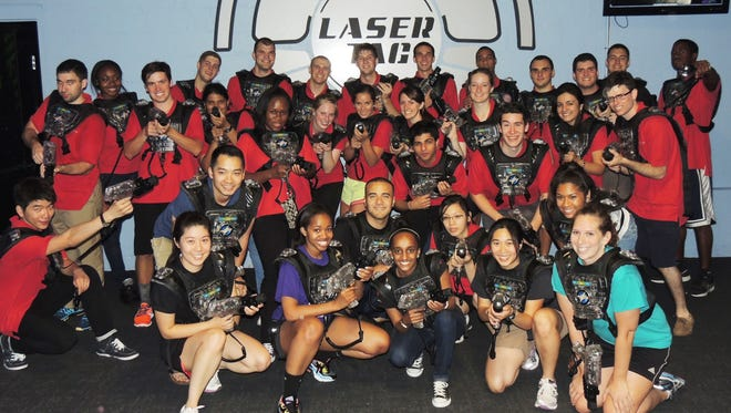 Employees on a company outing enjoy laser tag at Branchburg Sports Complex.