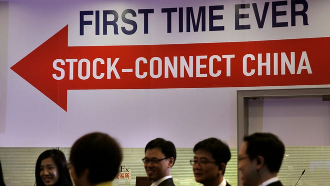 Staffers stand in front of the stage after the launch ceremony of the Shanghai-Hong Kong Stock Connect in Hong Kong  Nov. 17.